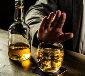 man-turning-down-whisky-nnn-300x267